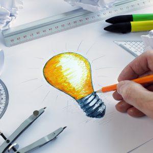 bigstock Designer drawing a light bulb 59047460